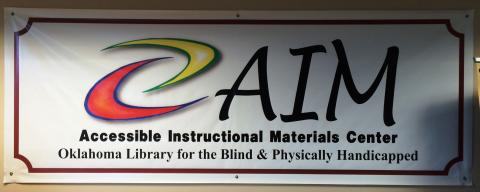 "Banner that reads ""AIM, Accessible Instructional Materials Center. Oklahoma Library for the Blind and Physically Handicapped"""