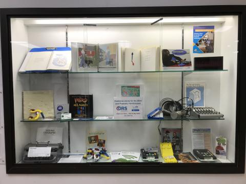 Glass-covered display case containing a wide variety of OLBPH items